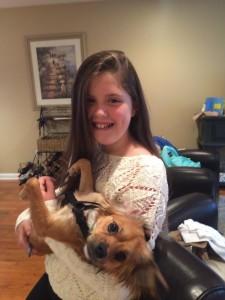 Tara Panagos and her dog.  Photo courtesy of: Coach Panagos